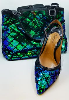 Available at Lena's Shoes and Fashions: J. Renee Shoes for Women (Chinaetta pumps - $89.00, Chinaetta clutch - $99.00)