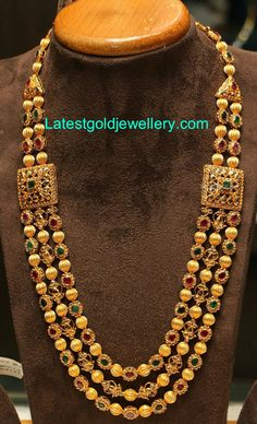 Rich three stringed haram with gold balls and floral design studded with uncut diamonds, rubies and emeralds, square shaped brooches on either side studded with uncut diamonds and emeralds by Manepally Jewellers. Indian Wedding Jewelry, Indian Jewelry, Bridal Jewelry, Indian Necklace, Gold Jewelry Simple, Uncut Diamond, Gold Jewellery Design, Schmuck Design, Jewelry Patterns