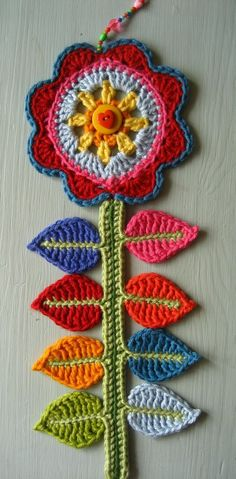 crochet flower wall art by Attic 24 I have her blog marked, and I am keeping my fingers crosse she posts instructions…this would be great for some ladies who are undergoing cancer treatments…