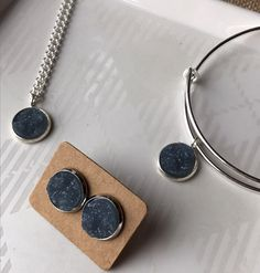A personal favorite from my Etsy shop https://www.etsy.com/listing/493335841/elegant-gray-druzy-in-silver-gift-set