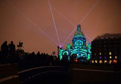 People watch a light show projected on the city's famed St. Isaac's Cathedral during the Festival of Lights in Saint Petersburg, on November 4, 2016.