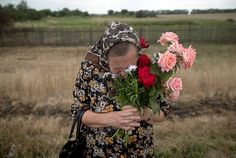 This picture makes me cry.  Ukrainians are beautiful, fun loving and kind people - which makes them vulnerable to the brutality of Russia.  Bless this beautiful woman. >>Near the village of Grabove, eastern Ukraine.