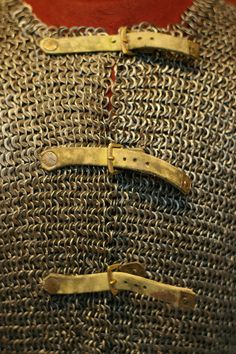 European (German?) riveted mail hauberk, 15th century, detail view, steel and brass links, modern buckles and straps, overall - l:76.20 cm (l:30 inches) Wt: 10.47 kg Sleeves - l:43.20 cm (l:17 inches). Cleveland Museum of Art, OH, USA. F6.