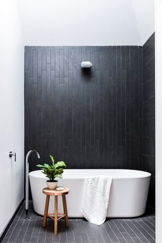 "A lightwell illuminates moody charcoal ceramics. ""At night, LED strip lighting makes the water from the rainshower glisten,"" says Carlo. Forme bath, [Harvey Norman](http://www.harveynorman.com.au/?utm_campaign=supplier/