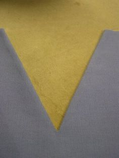 Great tutorial of how to sew a v neck. Also, How to correct a sewing mistake while doing a v neck.