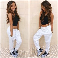 Kickback Swag girl look. Grey Jordans and Harem shorts with a short top. Good look