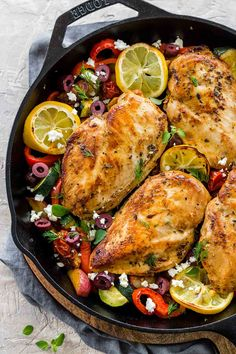 Greek chicken with roasted potatoes and lemon in a cast iron skillet