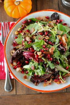Pomegranate Hazelnut Holiday Salad with Maple Bacon Dressing  8 cups Mixed Greens  12 slices Bacon, cooked and crumbled  ¾ cups Chopped, Toasted Hazelnuts  1 whole Pomegranate, Peeled And Arils Removed  FOR THE DRESSING:  3 Tablespoons Warm Bacon Grease (reserved From Cooking The Bacon)  2 Tablespoons Maple Syrup  2 Tablespoons Balsamic Vinegar  Salt And Pepper, to taste