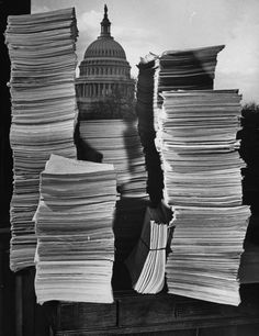 The physical casualty lists of the Second World War as of December 1944, including: US Marine Corps, the US Coast Guard (both piled to the left), the US Merchant Marines (small center bundle) and the rest all belonging to the US Army.