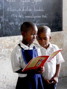 Two children reading. Preschool books and toddler books.