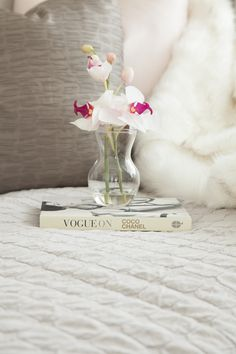 Pink orchid and white faux fur to complete the decor in teen girls bedroom -Designed by JHR Interiors