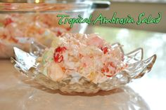 Tropical Ambrosia Salad -  perfect for summer potlucks! -  tropical fruit salad (pineapple and papaya), cherries, coconut, crushed pineapple, flavored mini marshmallows with cool whip!