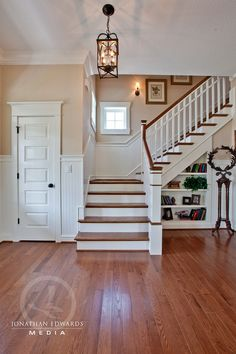 I like stairs that turn. And wainscoting. And the little window.