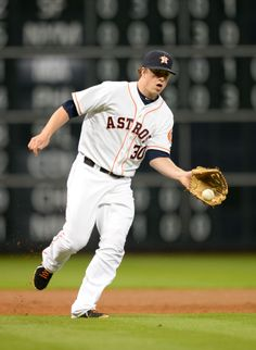 CrowdCam Hot Shot: Houston Astros third baseman Matt Dominguez fields a ground ball against the Cincinnati Reds during the fourth inning at Minute Maid Park. Photo by Thomas Campbell
