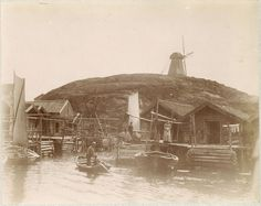 Fishing village Grundsund, Sweden, with boathouses and boats.  1870s