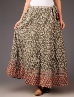 Buy Olive Rust Lotus Motifs Syahi Begar with Rogan Border This olive-rust cotton panelled skirt is adorned with syahi-begar lotus motifs and rogan borders. This flowy skirt is perfect for a boho chic ensemble paired with tribal jewelry. Flowy Skirt, Sequin Skirt, Cotton Skirt, Tribal Jewelry, Lehenga, Lotus, Rust, Print Patterns, Boho Chic