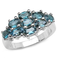 Framed by beauty, this cluster-ring is a great accent for your glamorous style! It holds genuine london blue topaz ovals weighing 3.15 carats, beautifully set in .925 sterling silver creating a dazzling look of remarkable feature!