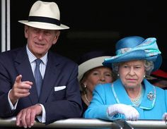 2002. Queen And Philip BEVERLEY, UNITED KINGDOM - JULY 12: Queen Elizabeth II Continuing Her Jubilee Tour At Beverley Racecourse Watching The Champagne Victor Queen's Golden Jubilee Handicap Stakes With Prince Philip In His Panama Sunhat (Photo by Tim Graham/Getty Images)