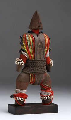 Africa   Doll from the Namji people of northern Cameroon   Wood, leather, glass beads, shells, metal, fiber