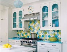 Try a multicolored backsplash and match it with miscellaneous items around your kitchen.