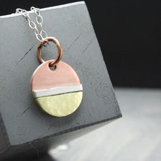 This charming geometric necklace is the perfect mix of metals. A little copper, brass and silver - all in one. Features & Measurements: ♥ 5/8 Copper Disc - Brass & Silver soldered on ♥ Sterling Silver