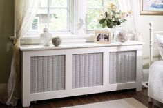 DIY radiator cover with storage (via canadianhomeworkshop.com)