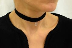 A suede wrap choker necklace with a sterling silver 925 charm. This black tie choker can be worn in many ways and is adjustable so it fits perfectly. Also comes in red, view here: http://etsy.me/2fpjxql Can view our store here: http://etsy.me/2grDjq9  .......Materials used: Cord = suede Pendant = sterling silver 925 Blue bead = ceramic  .......Length/Size: (If you would like a custom length please let us know) Inches: small size: 59 inches, me...