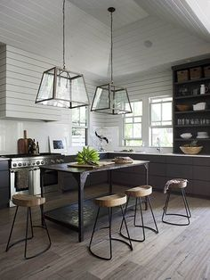 Get the look of this open and airy kitchen with these design tips: http://www.bhg.com/decorating/decorating-photos/kitchen/lofty-kitchen/?socsrc=bhgpin022015loftykitchen&kitchen