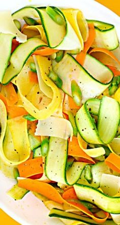 "Summer Vegetable ""Ribbon"" Salad. I added sliced almonds and used meyer lemon juicce. YUM and so pretty."