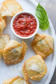 Super Simple Fresh Mozzarella And Basil Bites With Fresh Mozzarella, Eggs, Fresh Basil Leaves, Wonton Wrappers, Extra-virgin Olive Oil, Tomato Sauce
