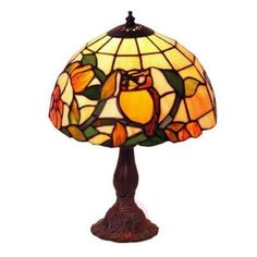 Tiffany style table lamp Juliana primarily comes in classical style and ensures pleasant light in the living room or on the bedside table