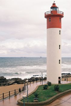 The Umhlanga Lighthouse, just north of Durban, South Africa, was built in front of the Oyster Box Hotel and has never had a keeper as the hotel had been the official warden.