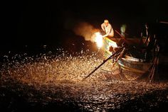 Under the darkness of the night sky, a small group of Taiwan fishermen set sail off the northeast coast, light a fire on the end of a bamboo stick using chemicals and wait for the fish to come.