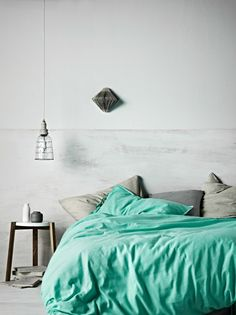 Such a tranquil bedroom with a pop of color.