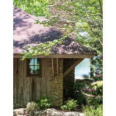 Nice exterior combination of stone old wood and corten steel roofing.