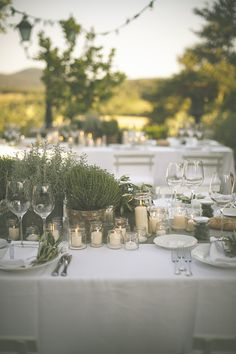 We agree with the long, rectangular table setup, but would prefer to have them with white tablecloths