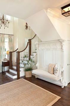 beautiful coastal foyer with ornate bench | Blue Sky Environments Interior Decor