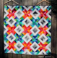 """Wonderful and bright 'Cross Stitch Sparkle"""" quilt by Cath Hall of Wombat Quilts. Quilting Tutorials, Quilting Projects, Quilting Designs, Quilting Ideas, Sewing Projects, Quilt Block Patterns, Quilt Blocks, Crochet Patterns, Postage Stamp Quilt"""
