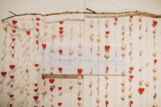 Paper hearts hanging from a twig.  From 'The Glasgow Wedding Collective, Sunday 4th May 2014, The Lighthouse, Glasgow' photographed by http://christophercurrie.co.uk/