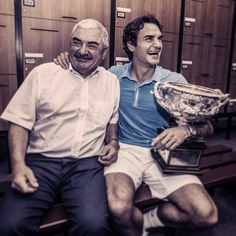 Roger Federer and his father after winning the French Open, 2009