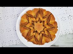 I made Braided Cinnamon Star Bread. In this video I show you step by step how to make the yeast dough, to layer it and how to shape into a beautiful star. En...