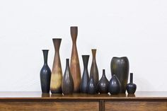 Set of eleven stoneware vases designed by Carl Harry Stålhane and Gunnar Nylund and hand made at Rörstrand in Sweden during the 1950s. They are glazed in hare's fur glaze in different shifting tones of rust, brown and black. All pieces are individually signed with artist initials, model no. and the Rörstrand hallmark. Height between 7-35 cm. Price for the whole set of eleven vases.