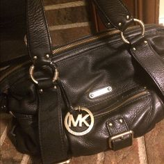 SALE MICHAEL by Michael Kors Classic Bag Black authentic Michael Kors leather bag. Great bag with a few small pockets for storage space. Minimal wear and tear. Some lip gloss stains inside.  Original duster bag included. MICHAEL Michael Kors Bags Satchels
