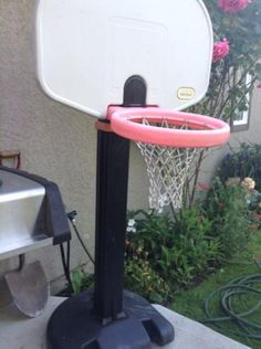 Little tykes basketball hoop. Base fills with water or sand. Pole extends for different height