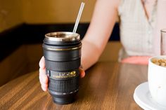 Nikon Camera Lens Mugs  A Thermos Lens and a Zoom Mug for your imbibing pleasure.
