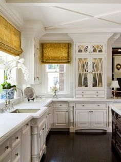 I don't like the window shades but otherwise, I really like this kitchen. My favorite is the cabinet with glass doors.