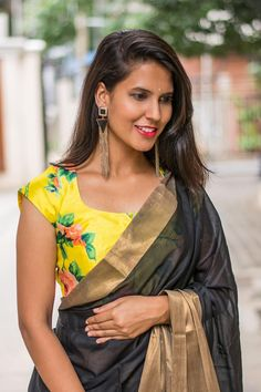 A simple U neck blouse in our ever popular floral yellow raw silk. Universally flattering U neck with cap length sleeves makes this a chirpy happy addition to any blouse wardrobe.   Contrast it with a black saree for some diva styling. Or pair with any of the colours in the blouse and look peachy fresh!