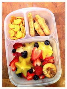 Star fruit salad, chicken peices & a grain.