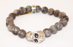 Astoria Couture - King Baby/10mm Labradorite Stretchy Beaded Bracelet w/Silver Day of The Dead Skull, $295.00 (http://www.astoriacouture.com/king-baby-10mm-labradorite-stretchy-beaded-bracelet-w-silver-day-of-the-dead-skull/)
