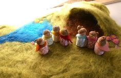 Waldorf inspired toys for pretend play. Meadow playscape made from felted wool, people made of wood, acorns and wool.